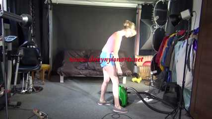 *** Sexy MIA wearing a lightblue shiny nylon shots and a pink while vacuum cleaning the studio (Video)***