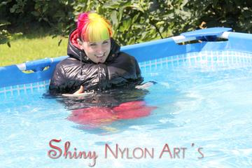 Mara sunbathing and swimming wearing supersexy crazy sensation shiny nylon downwear (Pics)
