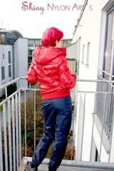 Marlin posing on a balcony wearing sexy black shiny nylon rainpants and a red down jacket (Pics)
