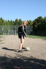 Leonie playing soccer outdoor wearing a sexy black shiny nylon shorts and a sexy black rain jacket (Pics)