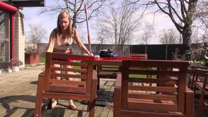 Watching sexy SANDRA wearing a supersexy special red shiny nylon shorts and a white top sweeping the terrace in the SUN enjoying the shiny weather (Video)
