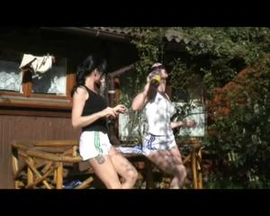 Jill and a friend of her sun bathing wearing sexy shiny nylon shorts and top (Video)