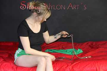 Watching ***NEW MODELL MIA*** during her selfbondage with cuffs and a clothgag wearing a sexy green shiny nylon shorts and a black top (Pics)