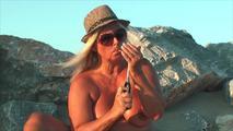 Smoking nude on the beach 5