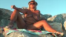 Smoking nude on the beach 7