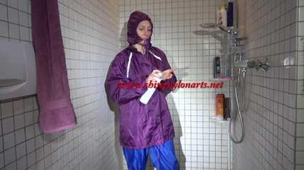 Sexy Sandra during her shaving cream action in the shower wearing a sexy blue shiny nylon rain pants and a shiny nylon purple rain jacket (Video)