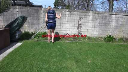 Sexy Sandra wearing a sexy darkblue shiny nylon shorts and a blue downvest during her gardening work (Video)