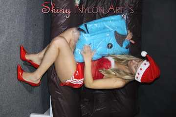 Watching sexy Sandra wearing a sexy red/white santaclause outfit with highheels packing presents (Pics)