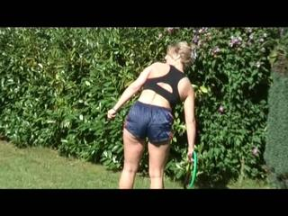 Sophie during the gardening wearing a sexy shiny nylon shorts and a hot top (Video)