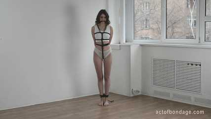 Girl with dirty feet in rope bondage