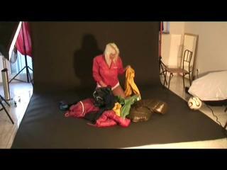 Blonde-haired archive girl posing in sexy shiny nylon rainwear (Video)