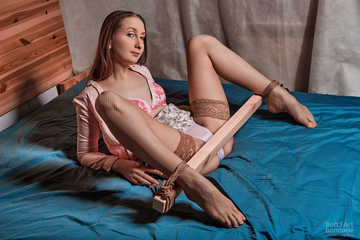 Sexual spreaded legs with jute and wood in pink clothes