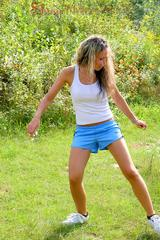 Sophie and Petra playing soccer outdoor wearing sexy shiny nylon shorts and a top (Pics)