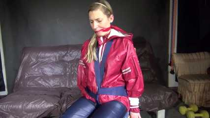 Watching sexy SANDRA being tied and gagged with ropes and a clothgag on a chair wearing sexy oldschool shiny nylon rainwear (Video)