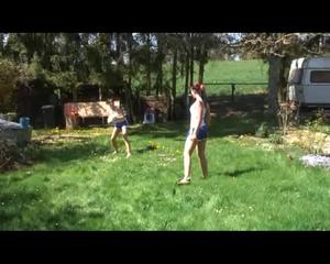 Jill and a friend of her playing soccer in the garden while wearing shiny nylon shorts (Video)