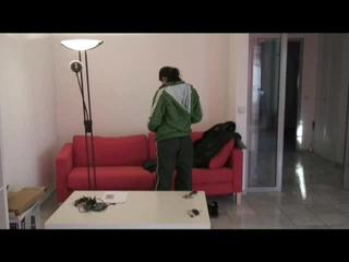 Enni dresses herself in shiny nylon shorts and rain cloths (Video)
