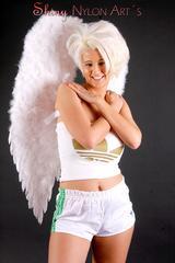 Angel wearing sexy shiny nylon shorts and a top (Pics)