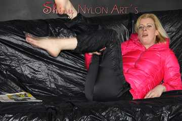 Watching sexy Pia wearing  a sexy black shiny nylon rain pants and a pink down jacket enjoying herself and lolling on the sofa (Pics)