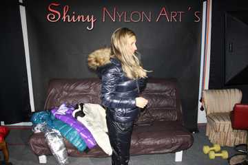 Watching sexy Sandra wearing a sexy shiny nylon black catsuit and trying on several down jackets (Pics)