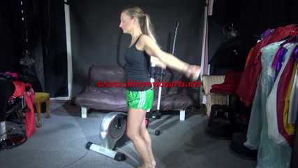 Watching sexy Sandra during her workout wearing a sexy green shiny nylon shorts and a black top (Video)