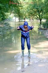 Stella jumping in puddles wearing sexy blue shiny nylon rainwear and rubber boots (Pics)