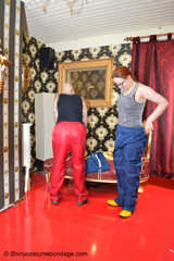 Miss Francine and Lady Nadja in AGU rainwear handcuff and ballgag each other