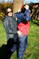Jill and her friend in the garden playing with eachother wearing sexy shiny nylon rainwear (Pics)