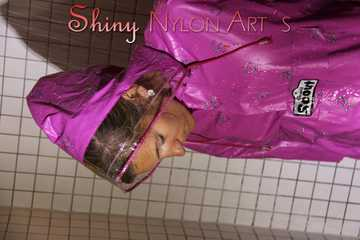 Watching Sandra wearing only a pink shiny nylon raincape under the shower playing with the water (Pics)