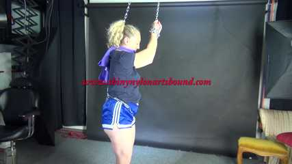 Watching Sophie being tied and gagged overhead with chains and a clothgag wearing a hot shiny nylon shorts and a tshirt (Video)