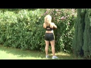 Sophie gardening wearing sexy shiny nylon shorts and top (Video)
