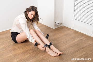 Elegant Disha chained on the floor. Photos