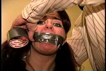 23 YR OLD REAL ESTATE BROKER IS MOUTH STUFFED WITH A SPONGE, WRAP TAPE GAGGED, GAG TALKING, RAG STUFFED IN MOUTH AND TIGHTLY HANDGAGGED  (D74-15)