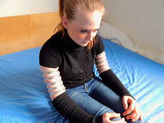 Lea wearing five very tight hose clamps on each arm