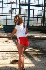 Stella posing outdoor wearing a supersexy red shiny nylon shorts and a white top (Pics)