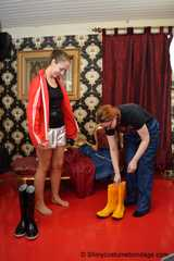 Lady Nadja and Miss Scarlett in  AGU rainwear trying bondage and a new harness gag