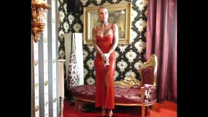 Miss Francine bound and gagged in a long red Latex dress  making off video part 2