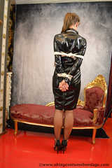 Miss Scarlett bound and gagged in full PVC outfit and transparent raincoat