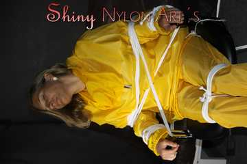 Sandra being tied and gagged on a hairdresser´s chair wearing sexy yellow shiny nylon rainwear being double hooded (Pics)