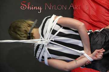 Sexy Pia wearing a sexy black shiny nylon shorts and a top being tied and gagged with ropes and a cloth gag overhead (Pics)
