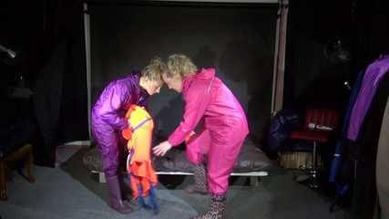 Watching Sandra and Sophie wearing sexy shiny nylon rainwear and helping eachother putting on the lifevests the other way round (Video)