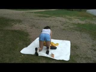 Being with Enni sitting at a lake wearing sexy shiny nylon rainwear (Video)
