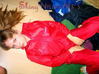 Leonie playing with nylon clothes ans posing sexy infront of the camera wearing sexy shiny nylon rainwear (Pics)