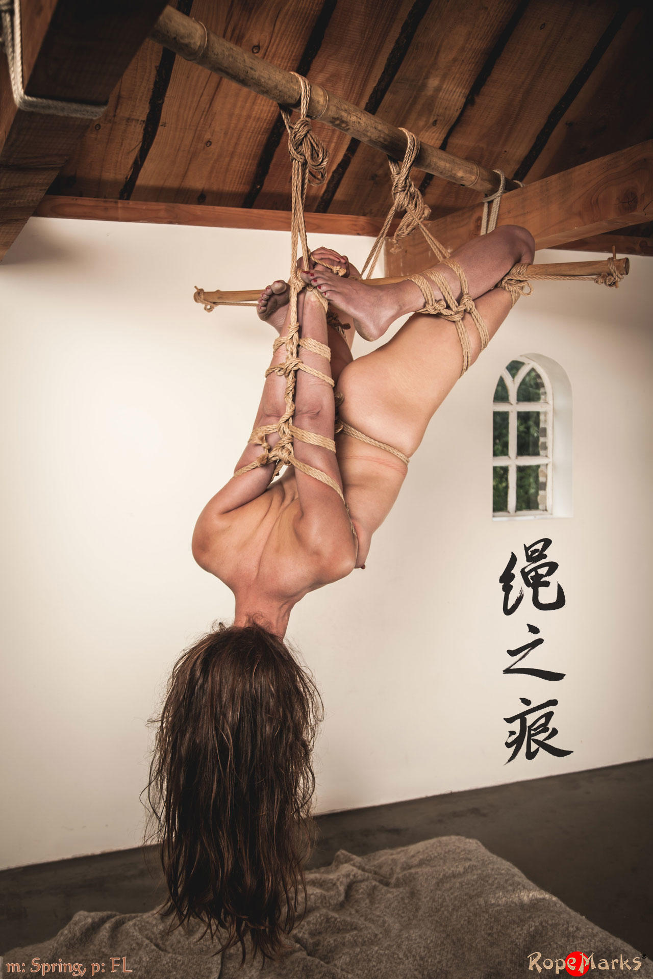 Rope bondage pictures using bamboo poles