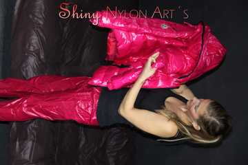 Watching sexy Sandra wearing a sexy pink shiny nylon rain pants and a pink down jacket nestle down in a down cover (Pics)