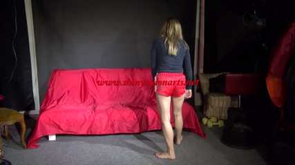 Sexy Sandra preparing her bed with yellow shiny nylon cloth wearing a sey red shiny nylon shorts and a black tshirt (Video)