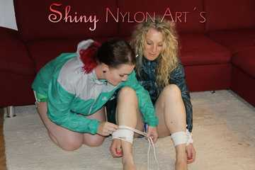 Watching Jill and Sophie tying and gagging eachother both wearing sexy shiny nylon shorts and rain jackets (Pics)