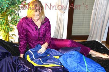 Pia tidies up the cupboard wearing supersexy purple shiny nylon rainwear (Pics)