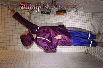Sexy Sandra during her shaving cream action in the shower wearing a sexy blue shiny nylon rain pants and a shiny nylon purple rain jacket (Pics)